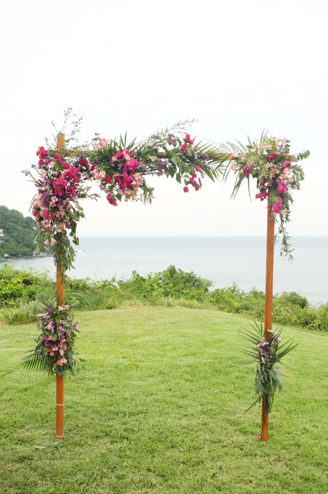 beautiful wedding arch with pink flowers