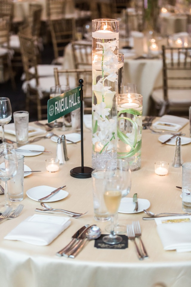 pillar floating candle wedding centerpiece with street sign table name