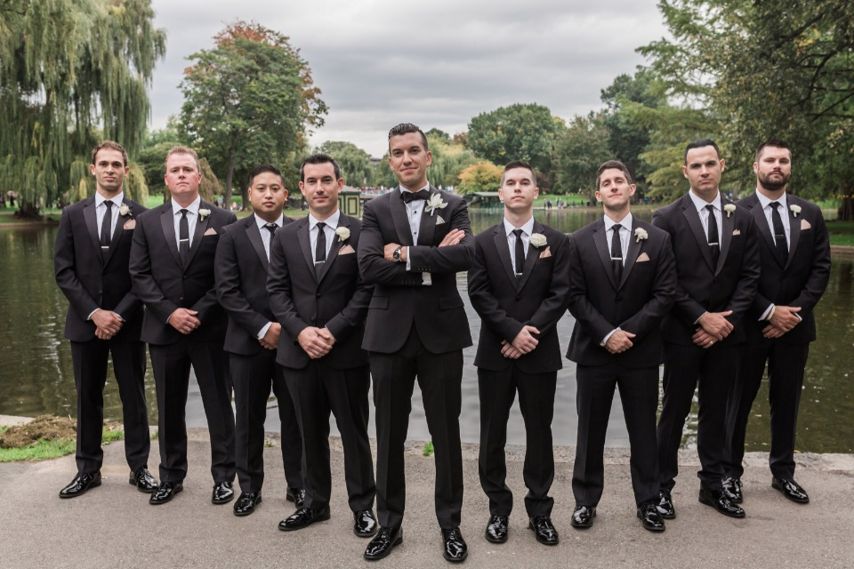 groom and his men in formal black tuxedos