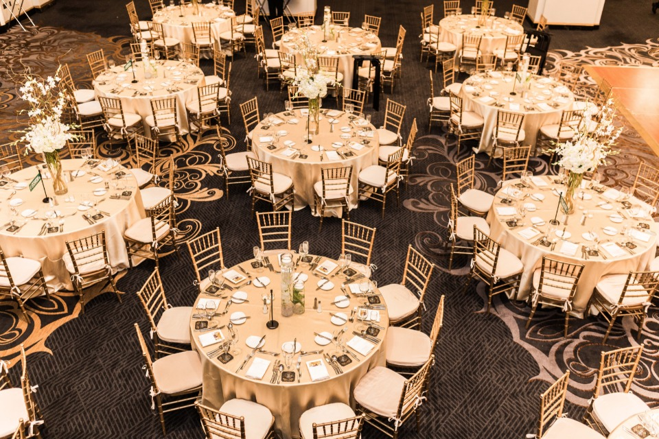 gold and white reception seating