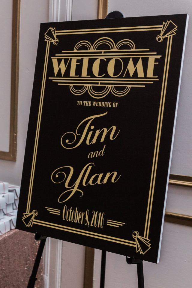 black and gold art deco wedding sign