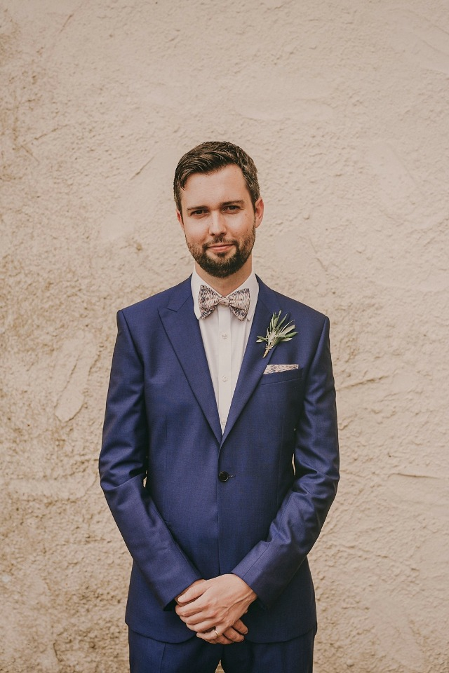 Dapper groom in a navy blue suit