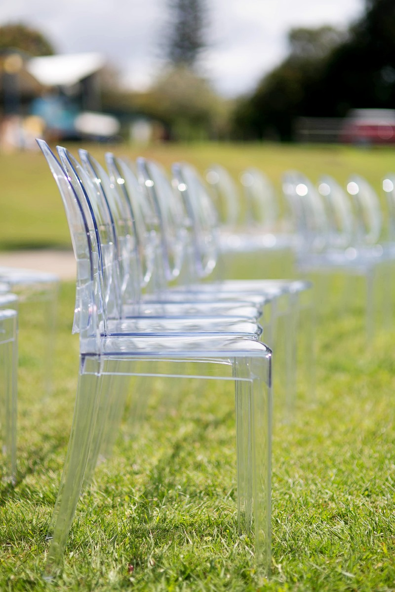 Luxury ghost chairs for the ultimate in elegant outdoor weddings available for hire from Brisbane Wedding Decorators