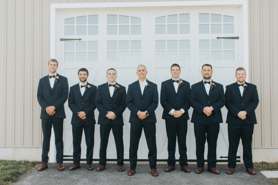 groom and his men in classic navy suits