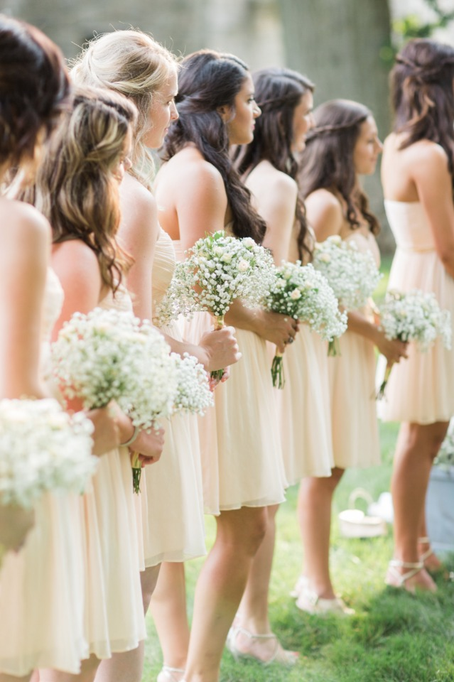 Bridesmaids with babys breath bouquets