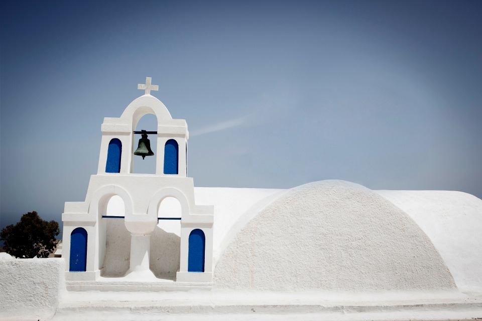 classic white and blue chapel in Greece
