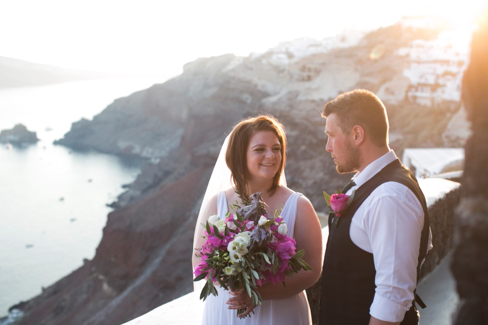 bride and groom at sunset in Greece