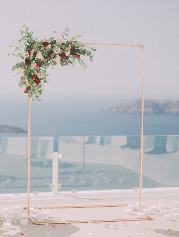 copper wedding backdrop with flower detailing