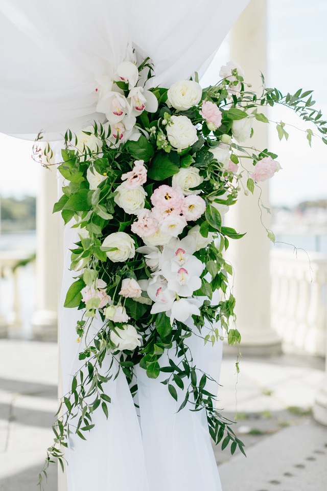 pink and white wedding ceremony floral decor