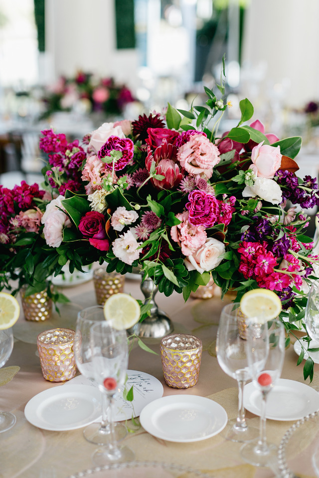 vibrant pink wedding centerpiece with protea
