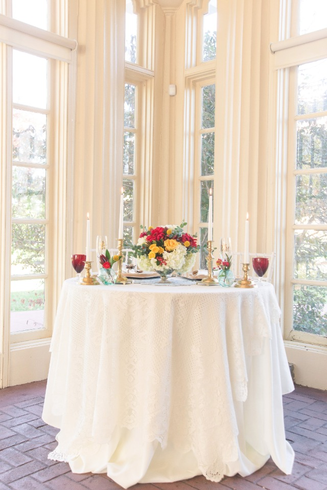 Simple red and gold sweetheart table decor