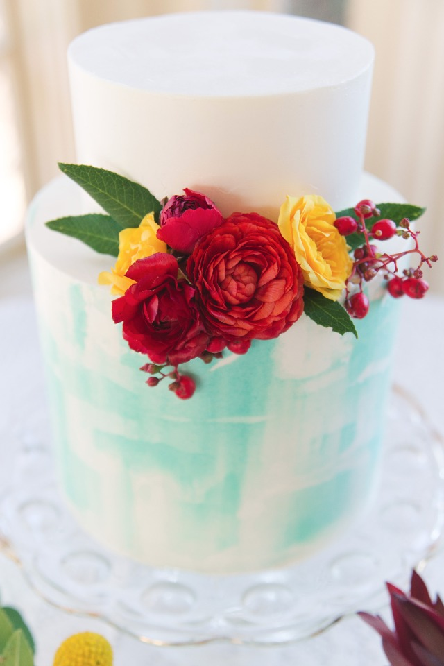 Blue watercolor cake with red and yellow florals