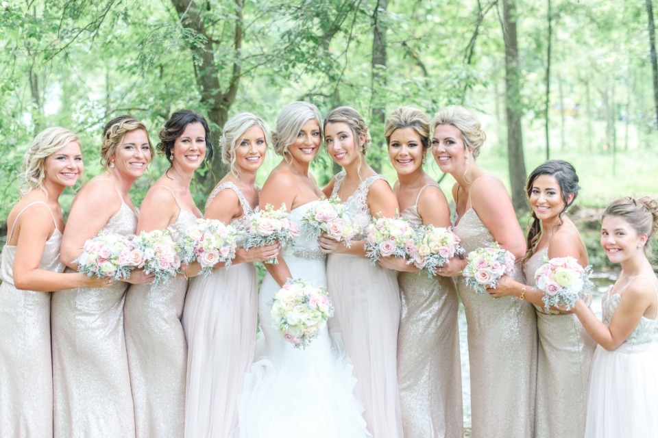 bridesmaids in shimmering sequin dresses in champagne