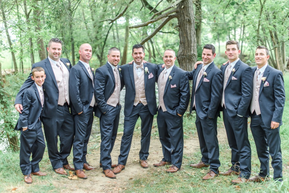 navy groomsmen suits with blush vests