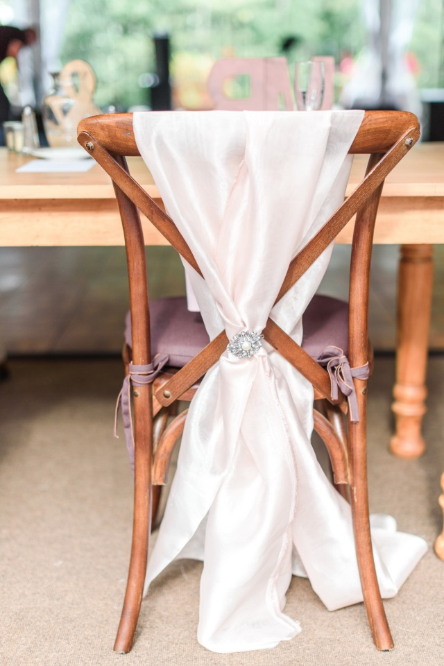 blush satin wedding chair draped