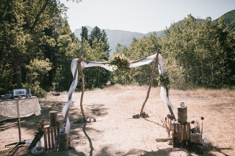 Rustic wood arbor with florals