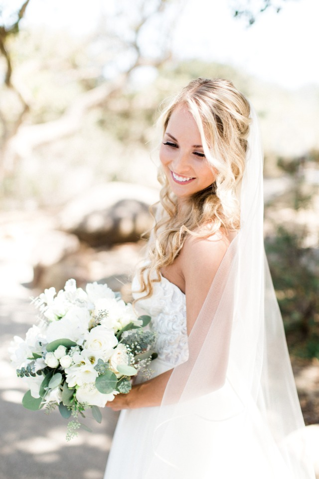 carefree wedding waves half up hair and all white bouquet