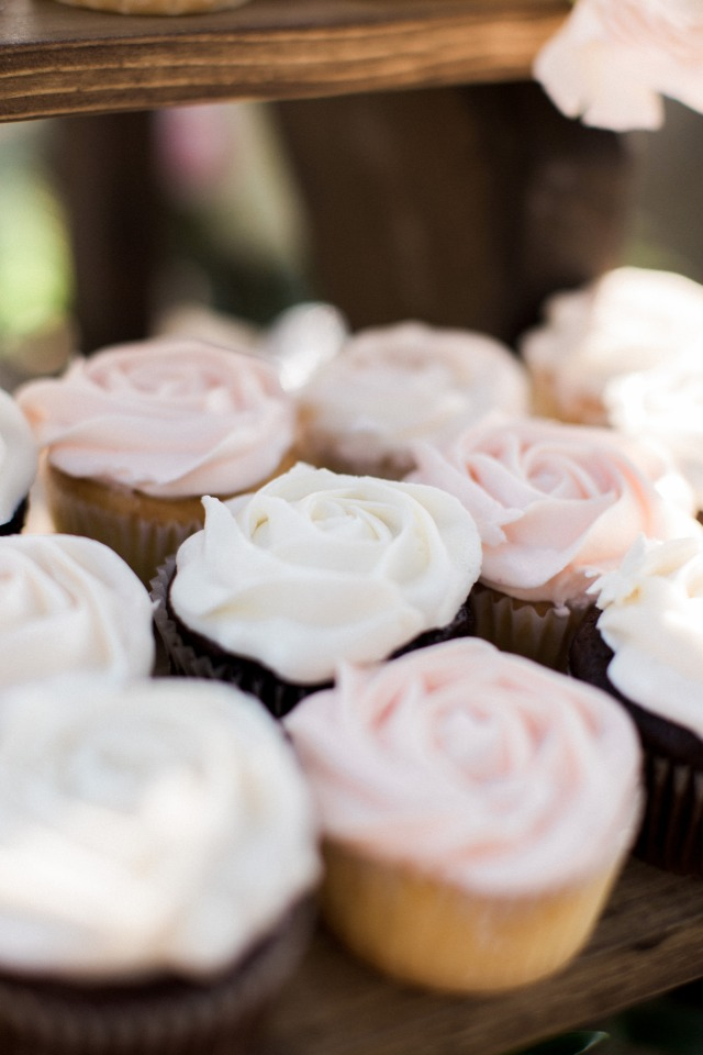 pink and white frosted wedding cupcakes