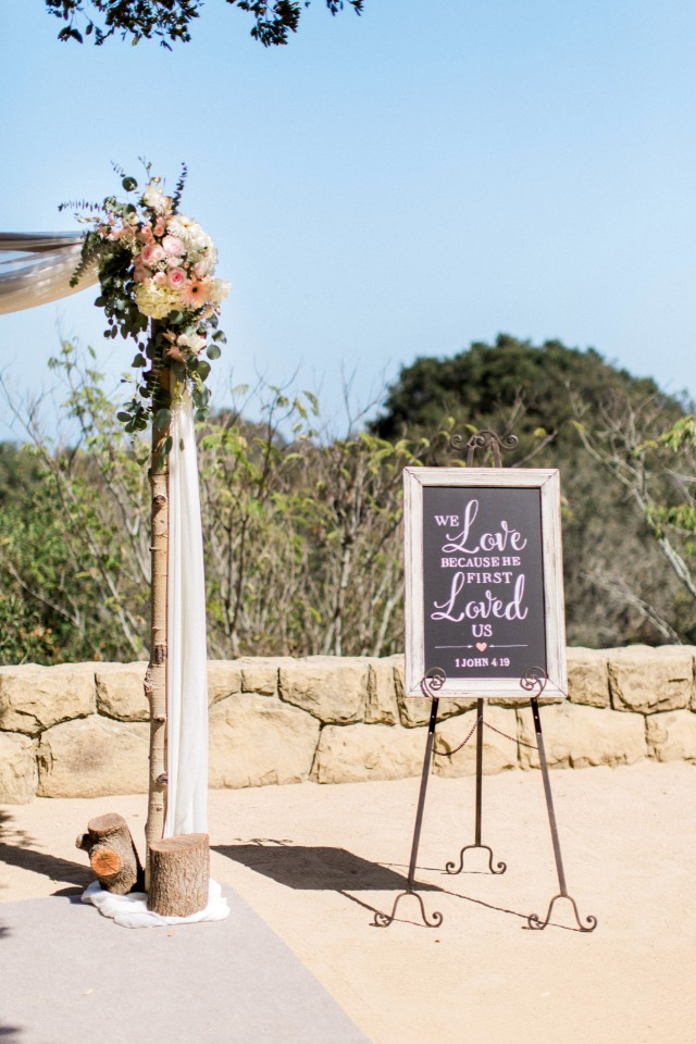 we love because he first loved us wedding ceremony sign