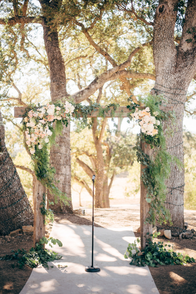 beautiful wood and flower wedding ceremony arch