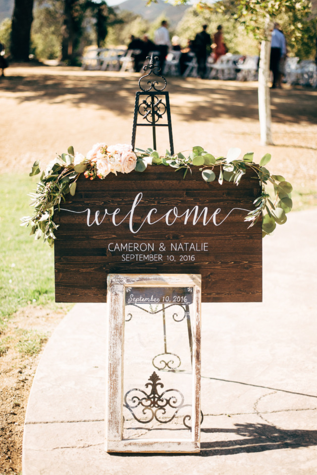 wood wedding welcome sign with flowers