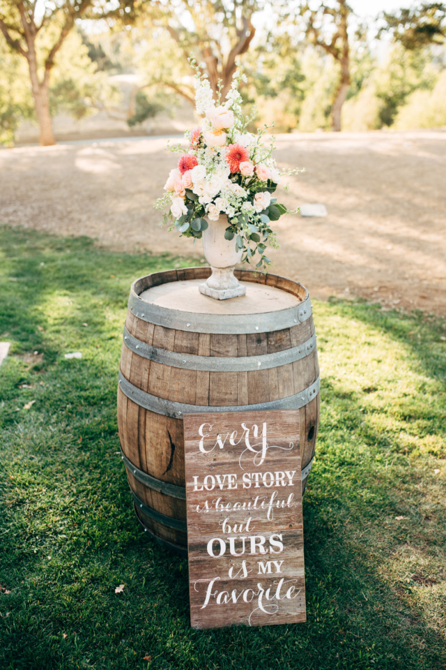 whiskey barrel and floral wedding decor