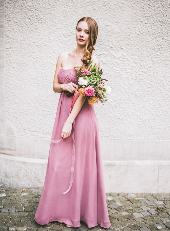 long pink and strapless bridesmaid dress