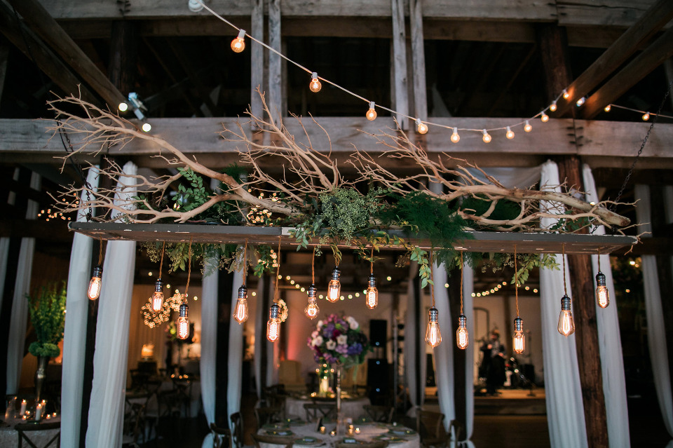 beautiful hanging floral and edison bulb decor