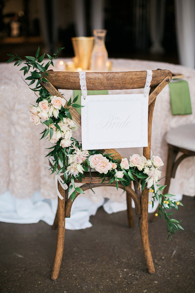 wedding bride seat with flowers and sign