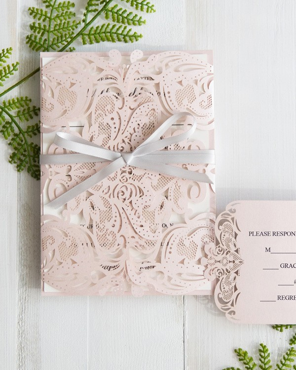 Pink laser cut wedding invites from Stylish Wedd