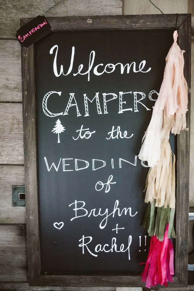 Welcome chalkboard sign with tassles