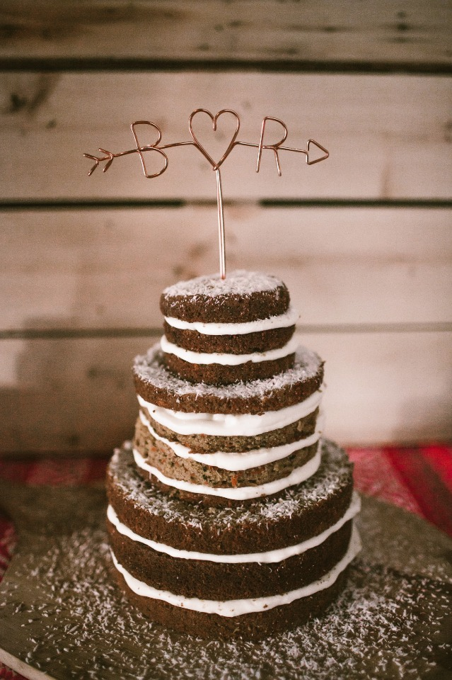 Naked wedding cake with metal initial topper