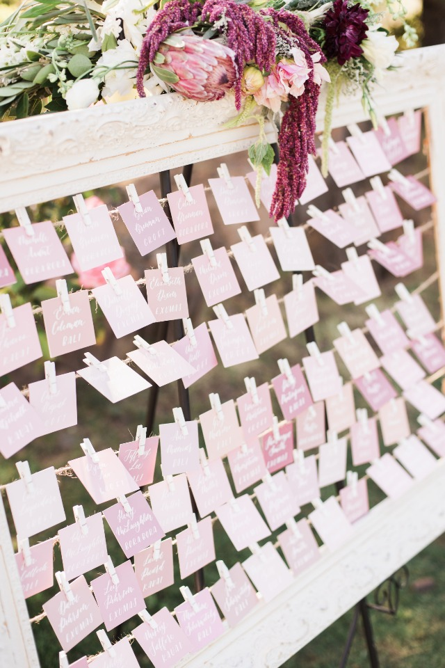 wedding escort cards in varying shades of pink