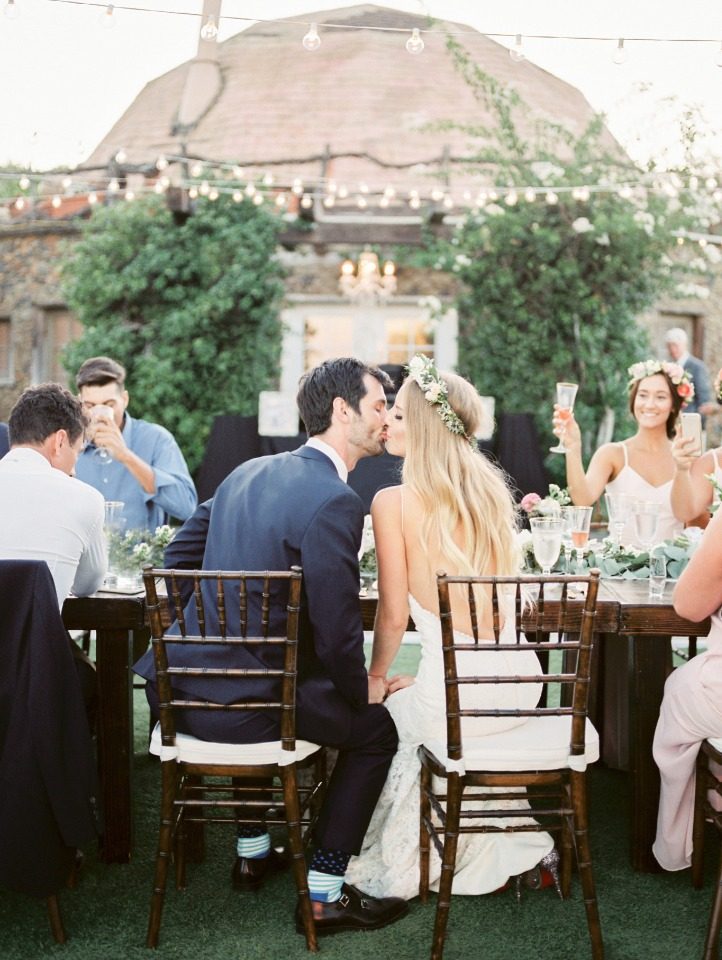 sweet bride and groom reception kiss