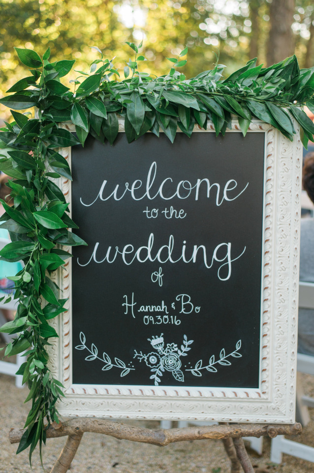 chalkboard wedding welcome sign with garland