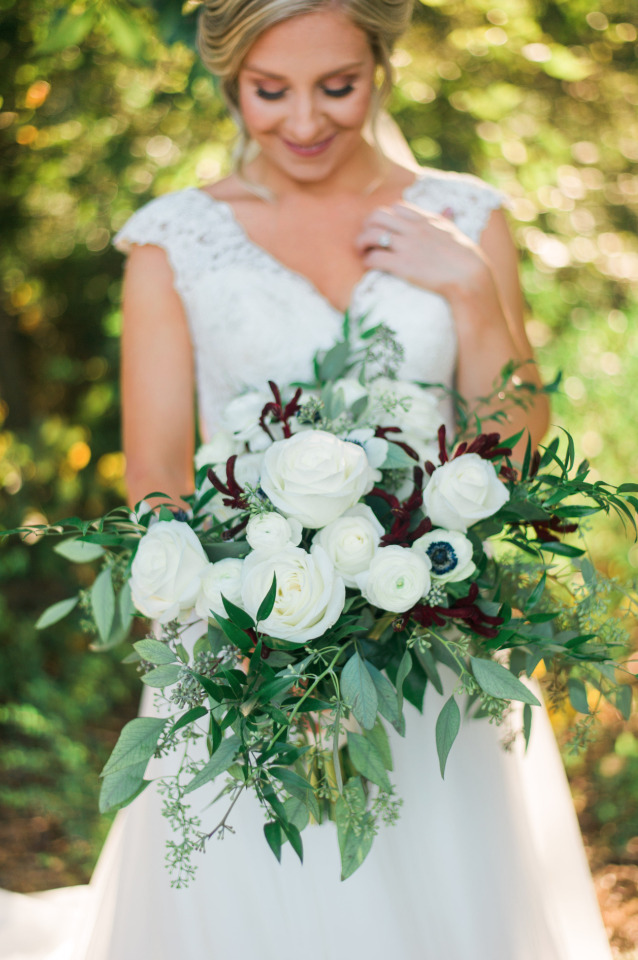 white wedding roses bouquet with ranunculus and anemone