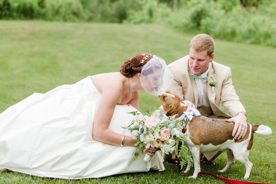 kiss the pup cute wedding photo