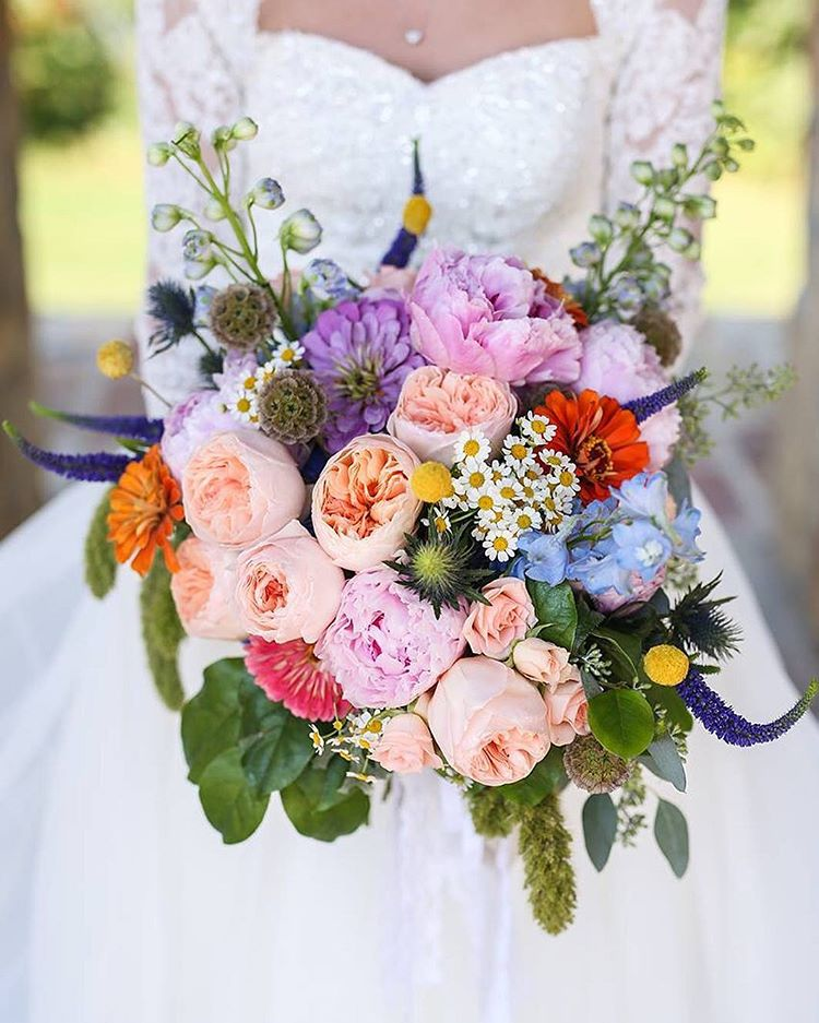 Wildflower wedding bouquet captured by an Arkansas, Missouri, Oklahoma wedding photographer