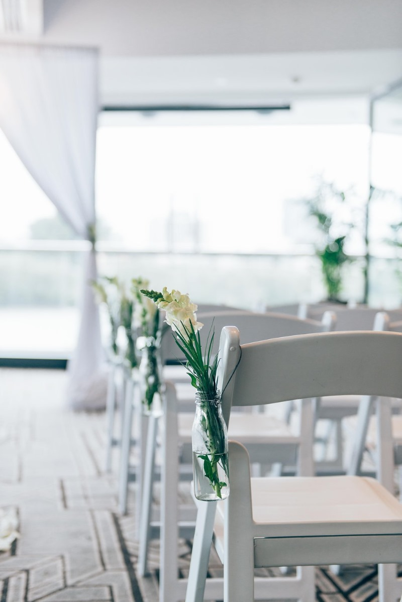 We are totally crushing on these fresh flowers lining the aisle of this white wedding at Blackbird Brisbane styled by Brisbane Wedding