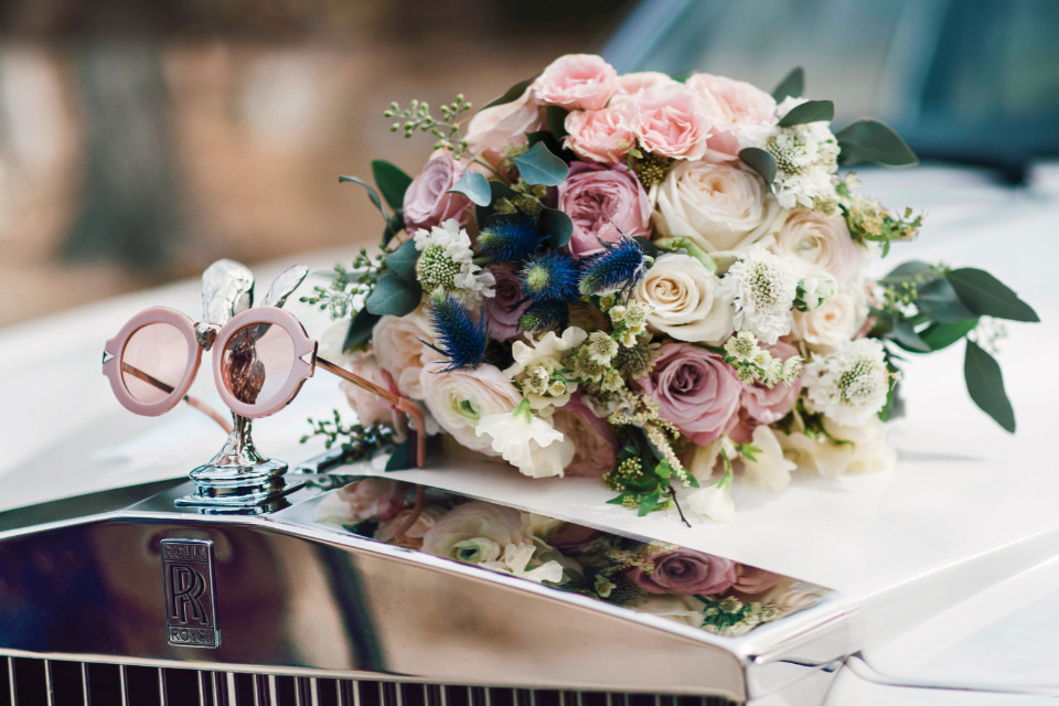 rose colored galsses and bouquet
