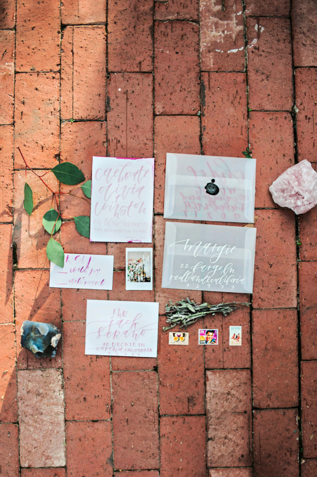 white and pink calligraphy wedding invites