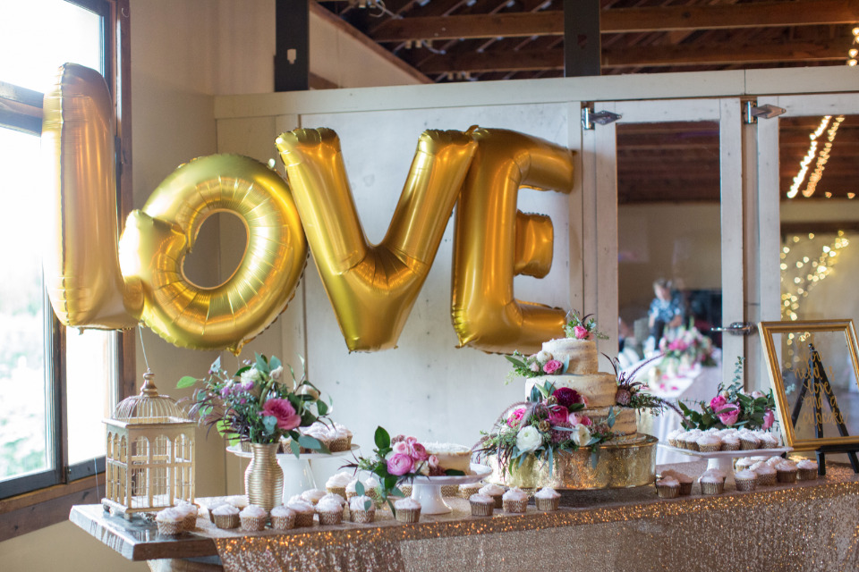 gold love balloons for wedding dessert table