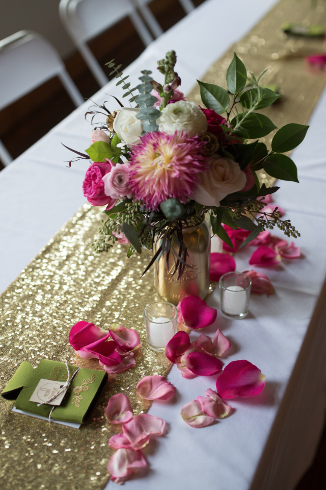 gold table runner and centerpiece with rose petal decor