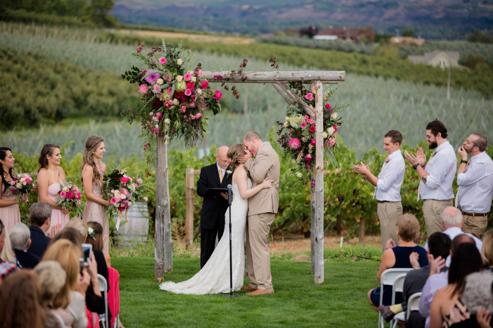 wood wedding arbor with floral decor