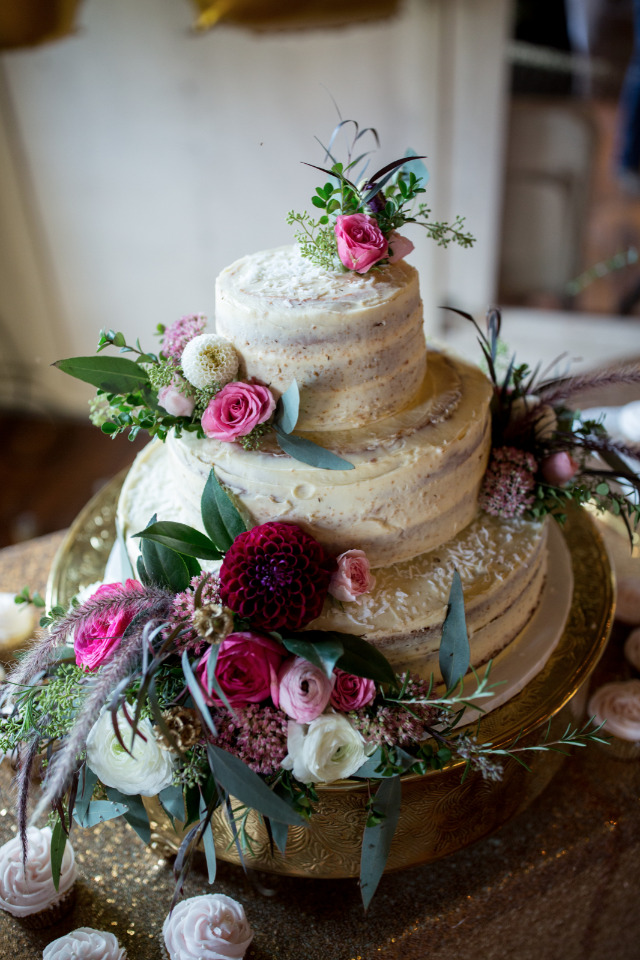 almost naked wedding cake with flowers