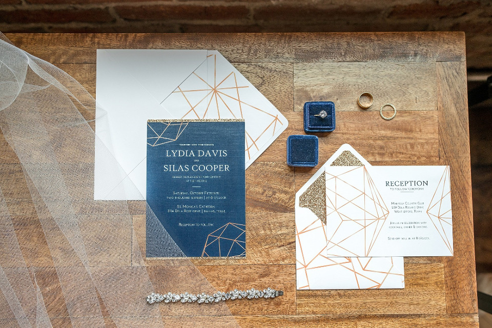 gold and navy geometric wedding stationery