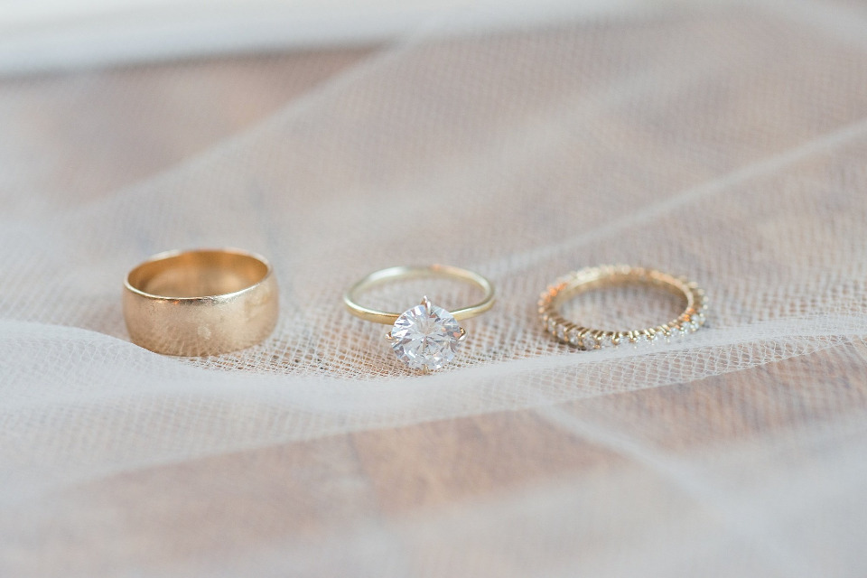 gold and diamond engagement ring and wedding bands