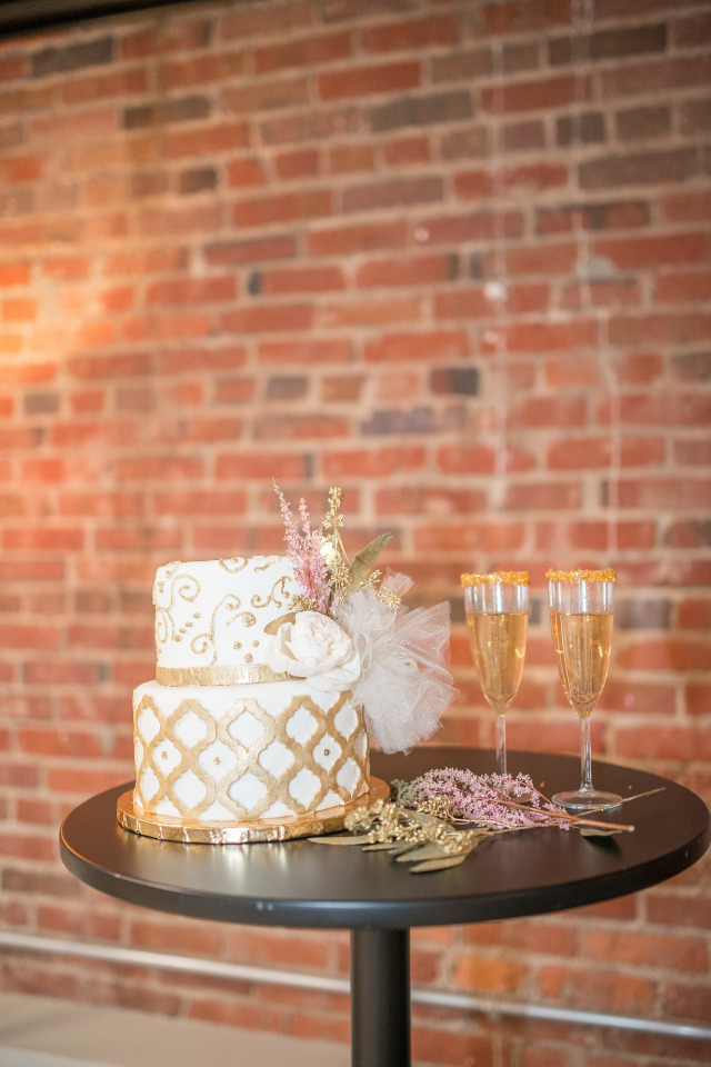 gold and white wedding cake and champagne