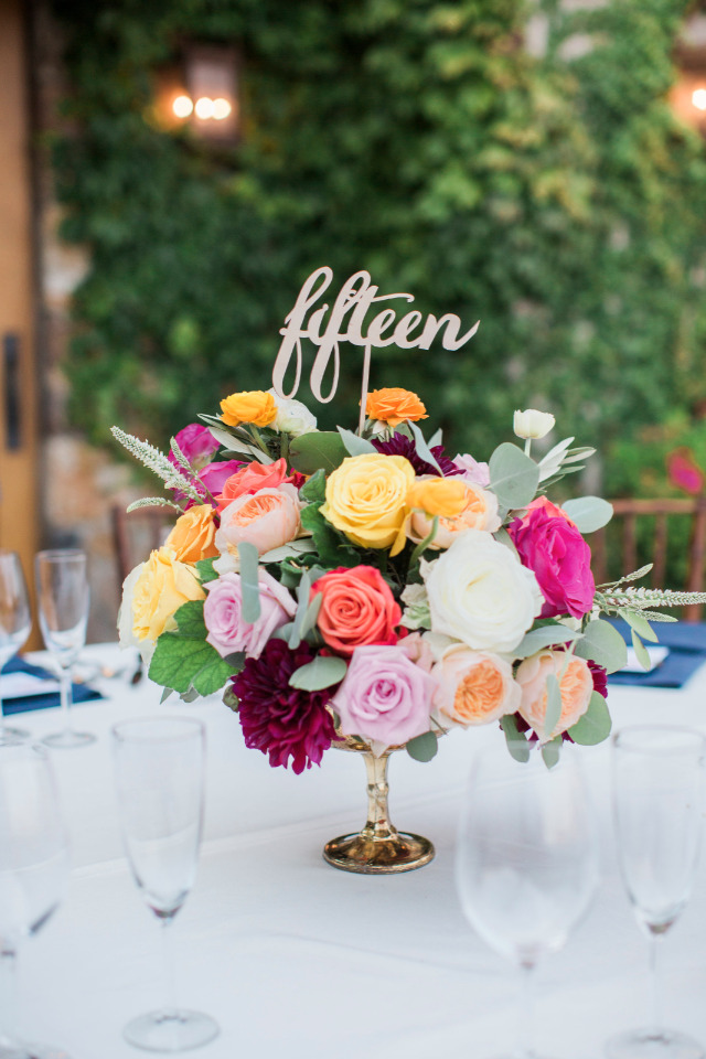 purple pink and yellow rose wedding centerpiece