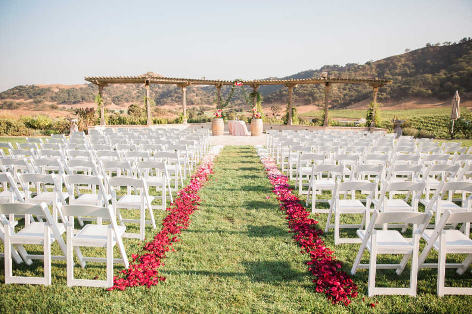 vineyard wedding ceremony with rose petals